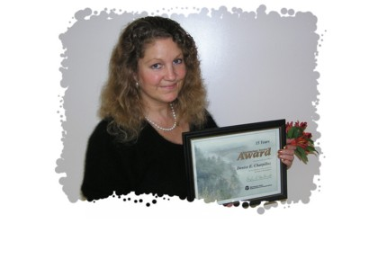photo of Denise and 15 year service plaque