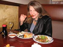 photo of Denise eating Asian meal