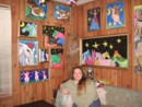 photo of Judy and her paintings