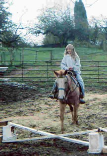 photo of Nikki learning to ride a horse