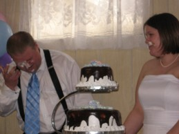 photo of wedding cake smeared on faces